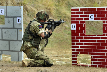 Britain's Prince Harry aims at the start of a live-firing exercise at the Up Park Camp in Kingston, Jamaica