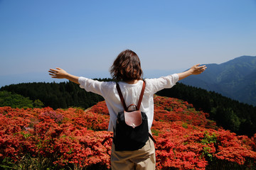 japanese young woman red flower mountain