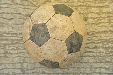 Old soccer ball on fall
