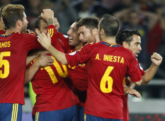 Spain's players celebrate a goal during their 2014 World Cup qualifying soccer match against Georgia at Boris Paichadze Stadium in Tbilisi