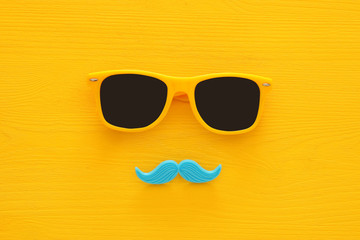 Father's day concept. Hipster yellow sunglasses and funny moustache