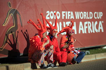 Dutch fans eat ice cream outside the Soccer City stadium before the FIFA World Cup 2010 final soccer match between Netherlands and Spain in Johannesburg