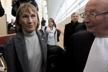 Christiane Marty, widow of the pilot, and her lawyer Roland Rappaport arrive at the courthouse of Pontoise, near Paris