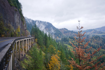 Panorama with autumn nature Columbia Gorge with truck overpass bridge