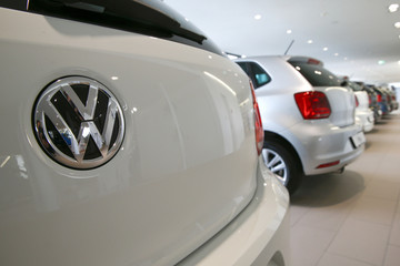 Logo of German carmaker Volkswagen is seen on a VW Golf car at a showroom of AMAG in Duebendorf
