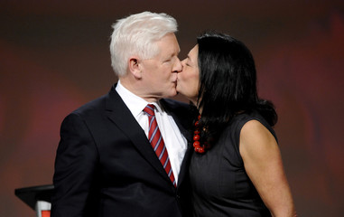 Interim Liberal leader Bob Rae and his wife Arlene Perly Rae kiss on stage at the Liberal Party of Canada Leadership Showcase in Toronto