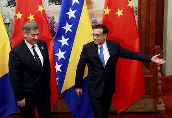 Denis Zvizdic follows Li Keqiang during their meeting, on the sidelines of the 4th Meeting of Heads of Government of China and Central and Eastern European Countries, at the Great Hall of the People in Beijing