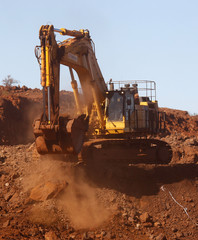 Trackhoe digs in the South Limb pit at Atlas Iron's Pardoo mine, near Port Hedland