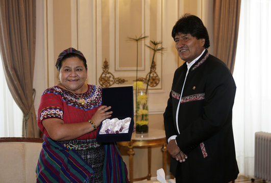 Guatemalan Nobel Peace Prize winner Rigoberta Menchu holds a gift from Bolivia's President Morales at the presidential palace in La Paz
