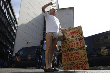 Man affected by a fall in the prices of preference shares of Spanish lender bank Bankia wears panties as he protests outside Parliament in Madrid