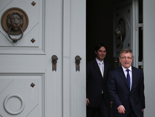 Hungary's newly minted central bank Governor Matolcsy and his deputy Balog, also newly appointed for the central bank, leave the Presidential palace after the swearing-in ceremony in Budapest