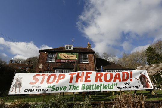 """Local pub """"The Plough"""" displays a large banner against the construction of the Hastings Bexhill link road in the Combe Haven valley at Crowhurst near Hastings south east England"""