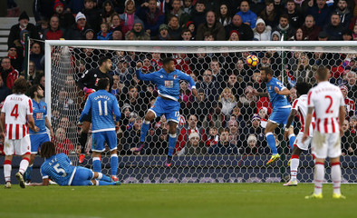 Bournemouth's Steve Cook clears the ball off the line