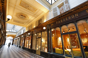Visitors walk in the Galerie Verot-Dorat which houses shops, art galleries, restaurants, and fashion boutiques in Paris