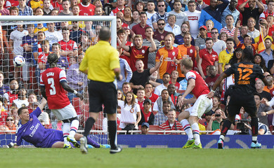 Drogba of Galatasaray scores past Arsenal goalkeeper Szczesny during their pre-season Emirates Cup soccer match in London