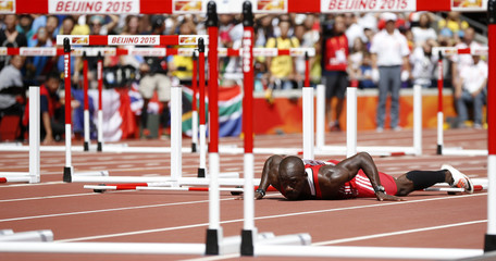 Thomas falls during his men's 110 metres hurdles heat at the IAAF World Championships at the National Stadium in Beijing