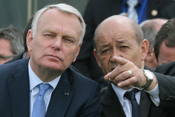 French Prime Minister Ayrault and Defence minister Le Drian attend flight demonstrations during the opening of the 50th Paris Air Show, at Le Bourget airport near Paris