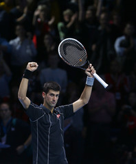 Novak Djokovic of Serbia celebrates after defeating Roger Federer of Switzerland in their men's singles tennis match at the ATP World Tour Finals at the O2 Arena in London