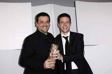 """Co-directors Joann Sfar (L) and Antoine Delesvaux pose with their trophy after winning the Best Animated Film Award for their film """"The Rabbi's Cat"""" during the 37th Cesar Awards ceremony in Paris"""