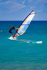 windsurfer at sea off the coast of Corfu, Greece, Europe