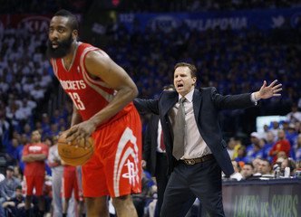 Oklahoma City Thunder head coach Scott Brooks shouts to his defense against Houston Rockets guard James Harden in the second half of their Game 2 NBA Playoffs basketball game in Oklahoma City