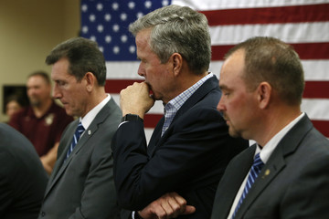Bush listens to other speakers after his portion of a town hall meeting with employees at FN America gun manufacturers in Columbia, South Carolina
