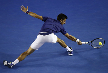 Serbia's Djokovic hits a shot during his semi-final match against Switzerland's Federer at the Australian Open tennis tournament at Melbourne Park