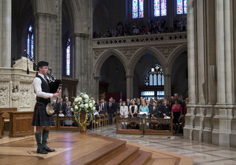 Angus Sutherland, of Kelso, Scotland plays the bagpipes during a memorial service for Apollo 11 astronaut Neil Armstrong at the National Cathedral in Washington