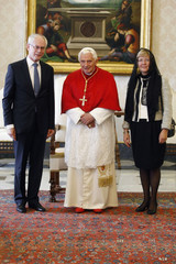 Pope Benedict XVI poses with President of the European Council Herman van Rompuy and his wife during a private audience in Vatican