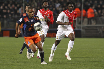 Montpellier's Marveaux challenges Monaco's  Nkoulou Ndoubena during their French Ligue 1 soccer match at the Mosson stadium in Montpellier