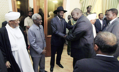 President of the Republic Bashir, First Vice President Kiir, Vice president Taha and Head of Justice Osman congratulate Sudan's new ministers at the Republican Palace in Khartoum