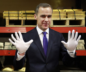 Bank of Canada Governor Carney holds up his hands before leaving a gold vault at the Royal Canadian Mint, after viewing some historic gold coins in Ottawa