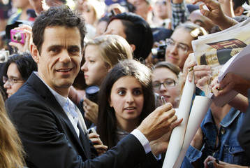 """Tykwer arrives on the red carpet for the gala presentation of the film """"Cloud Atlas"""" during the Toronto International Film Festival"""