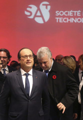 French President Francois Hollande and Quebec's Premier Philippe Couillard arrive to tour the Societe des Arts Technologiques in Montreal