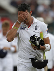 England's Pietersen walks off the pitch after being dismissed on the final day of the third Ashes test match at Old Trafford cricket ground in Manchester