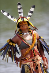 An indigenous woman from Kanela tribe poses for photos after participating in a parade of indigenous beauty during the first World Games for Indigenous Peoples in Palmas