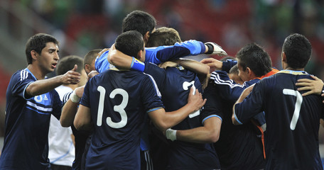 Argentina's players celebrate beating Uruguay in the the men's soccer semifinal at the Pan American Games in Guadalajara