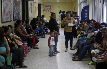 Pregnant women wait for a routine general checkup, which includes a test for mosquito-borne viruses like Zika, at the maternity ward of the Hospital Escuela in Tegucigalpa, Honduras