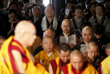 "Mongolian-born grand Sumo champion ""yokozuna"" Hakuho prays at public prayer for victims of March 11 earthquake and tsunami in Japan"