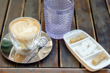 Coffee, glass of water and sugar