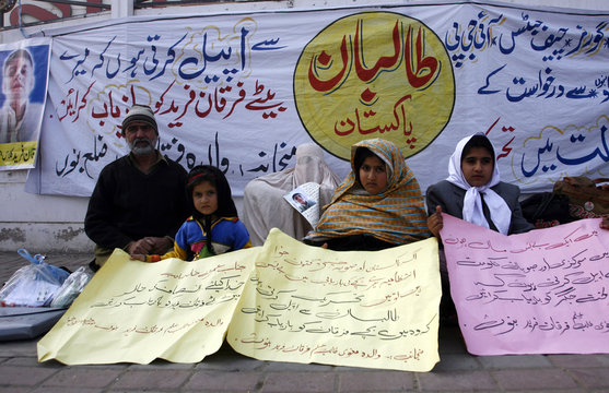 Fareed Khan, whose 11-year-old son was kidnapped by criminals more than a month ago, holds a sit-in with his family in front of the Peshawar Press Club in Peshawar