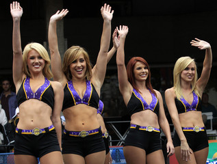 Members of the 'Laker Girls' wave during an event for basketball fans, in London