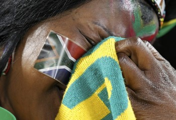 A South African fan weeps after the 2010 World Cup soccer match between South Africa and France in Bloemfontein