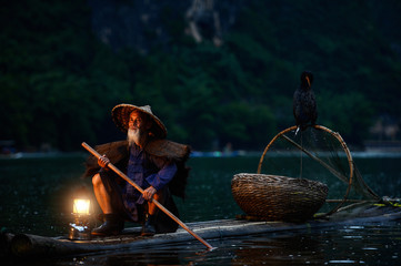 Fototapeten Guilin Fisherman of Guilin, Li River and Karst mountains during the blue hour of dawn,Guangxi China