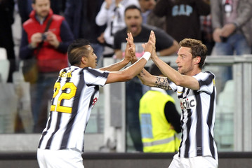 Juventus' Marchisio celebrates with teammate Vidal after scoring against Lecce during their Italian Serie A soccer match at the Juventus stadium in Turin