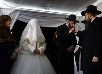 Israeli rabbinical student Feldman tastes a ceremonial glass of wine during his wedding with his Orthodox Jewish bride Oberlander in Budapest