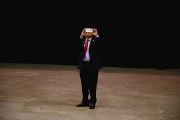 A supporter takes a picture before Republican U.S. Presidential nominee Donald Trump attends a campaign event at the Ocean Center in Daytona Beach, Florida