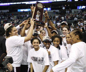 Texas A&M Aggies Carter and members of her team celebrate with the NCAA Dallas Regional trophy after beating the Baylor Lady Bears in their NCAA Women's Dallas Regional college basketball game in Texas