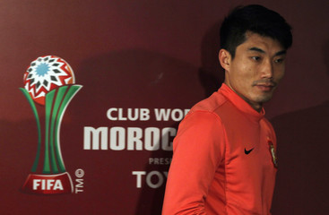 Zheng Zhi, captain of China's Guangzhou Evergrande, looks on after a news conference ahead of the Club World Cup, in Agadir