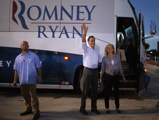 Republican presidential nominee Romney, with wife Ann at his side, wave to the crowd before leaving a campaign rally in St. Petersburg